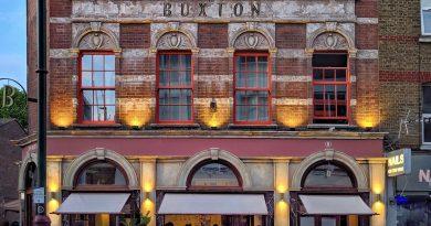 Street view of The Buxton pub and restaurant, Brick Lane, Whitechapel.